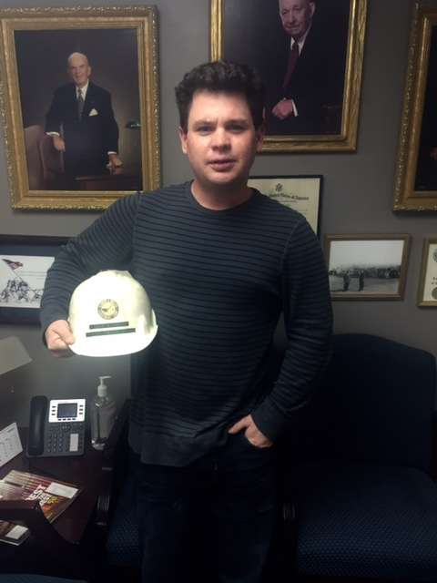 Rich Welch of the Welch Corporation received a hat from his cousin, Thomas Nolan.