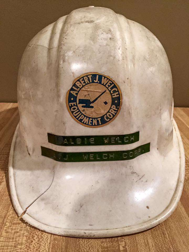 The hard hat that Welch received from his cousin, Thomas Nolan, is the shared keepsake of two grandsons.