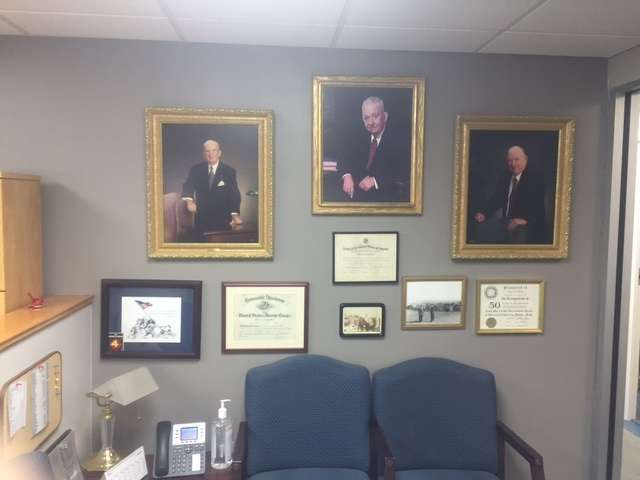 On the wall are the late Albert J. Welch Sr. (C), founder; the late Albert J. Welch Jr. (L), vice president and treasurer; and the late John E. Welch Sr., president.