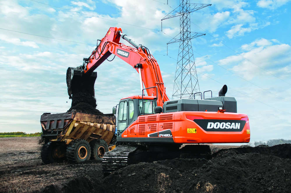 The company purchased the DX420LC-5 with a longer arm for approximately 40 ft. (12 m) of reach to help move dirt more efficiently.