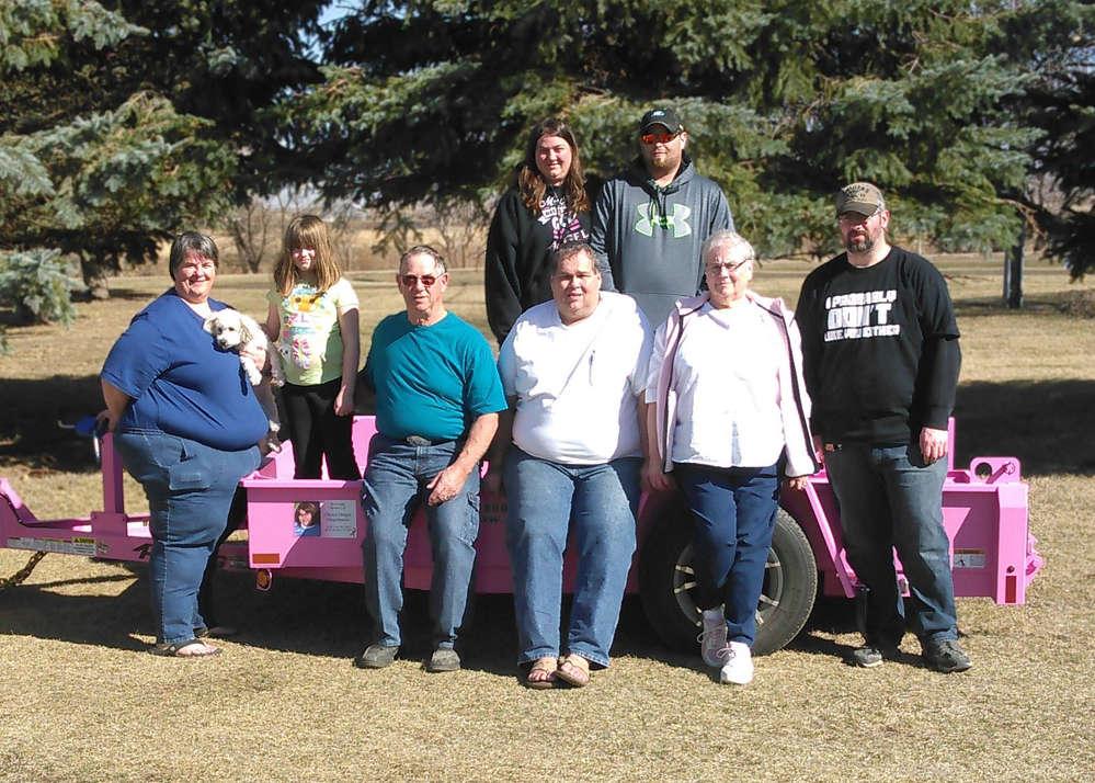 (L-R front row): Sandy Dinger, Cheryl's sister; Lily, Cheryl's granddaughter; Gerald, Cheryl's father; Jan, Cheryl's husband; Darlene, Cheryl's mother; Codey, Cheryl's son (L-R back row): Cathy, Cheryl's daughter and Curtis, Cheryl's son.