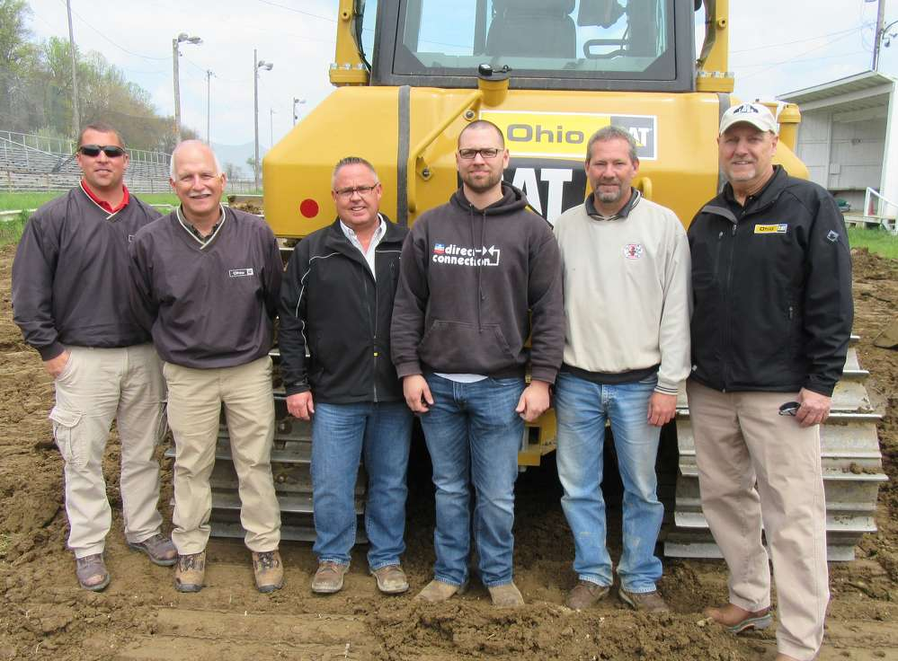 (L-R): Brad Fisher, Bob Stadvec and Erik Laps, Ohio CAT, join Mike Switzer and Todd Hoover, both of Independence Excavating Inc., and Phil Kuhar of Ohio CAT to review this Cat D6N dozer equipped with 3D Max.