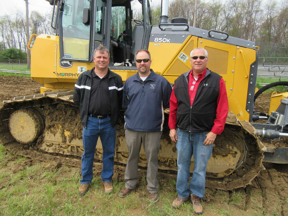 (L-R): Dave Russell, Chris Mears and Greg Fausel, all of Murphy Tractor and Equipment, present a John Deere 850K dozer equipped with Topcon's 3DMC2 system to attendees.