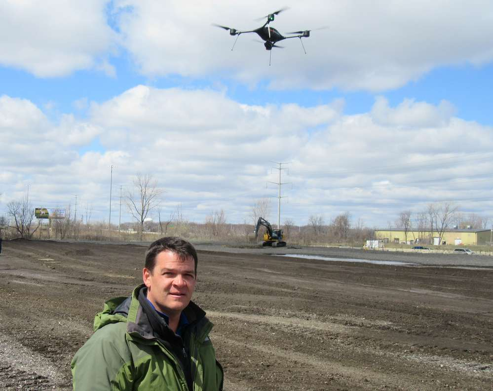 Scott Dunham,  imaging business  unit manager,  GeoShack, demonstrates a drone developed by Lockheed Martin, which is used for a variety of inspection and site mapping applications.