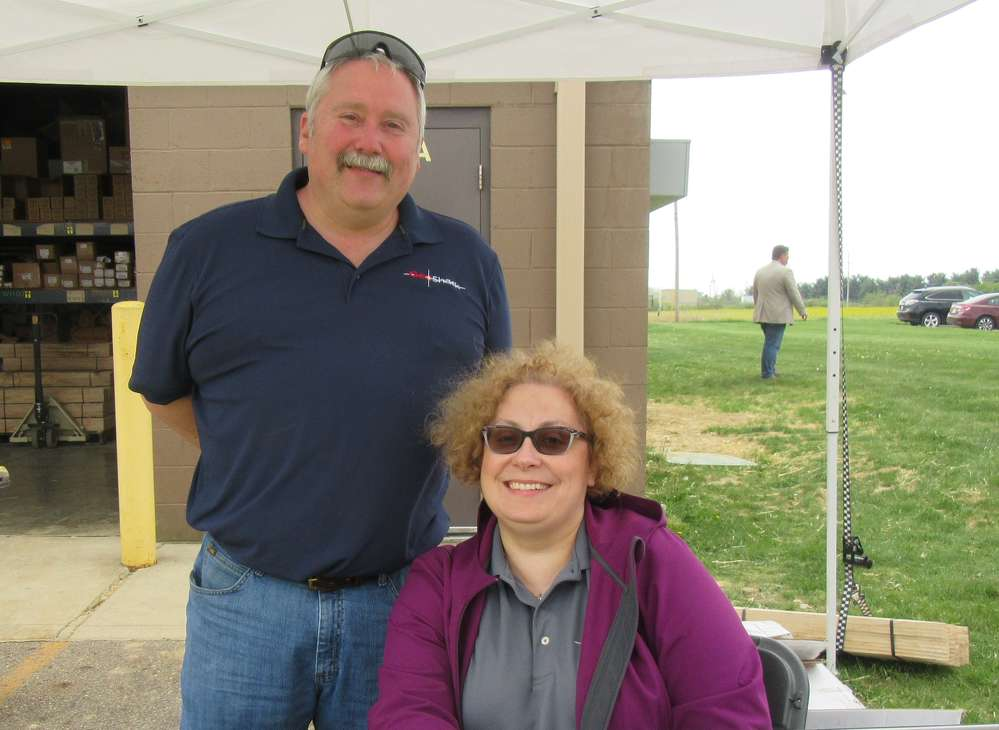 Rob Yoakum (L) and Angie Coughlin welcome attendees to the Columbus, Ohio, branch event.