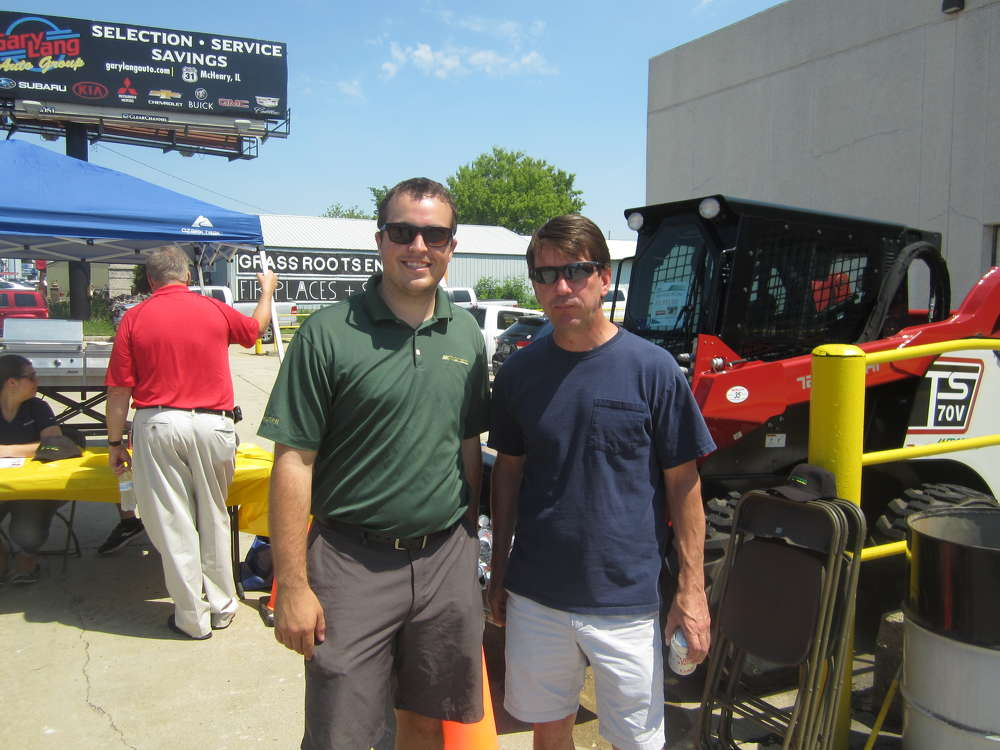 Jacob Wilson (L), McCann Industries, takes Ryan Hunt of BSB Development on a tour of the McCann Industries Wauconda branch.