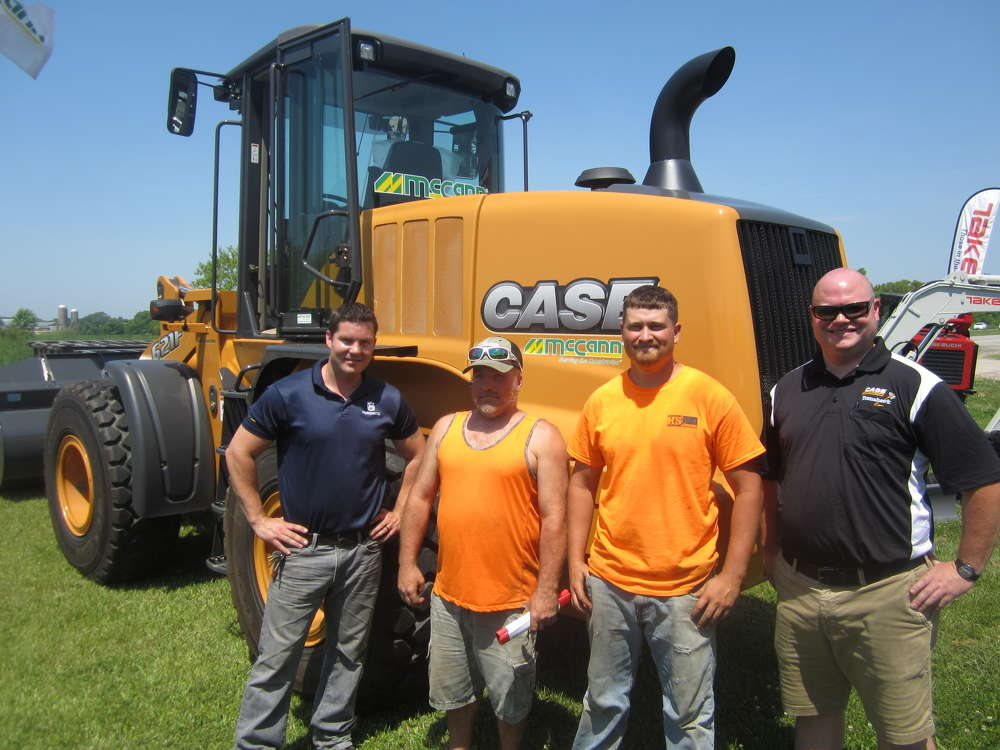 (L-R): Ben Mcburney, McCann Industries; Paul Stuart and Andy Bostic, both of H&S Concrete Constriction; and Brian Jones, McOCann Industries, stand in front of this Case 621F wheel loader.