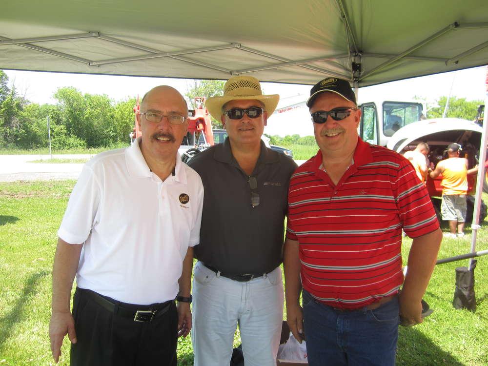 (L-R): Mark Shear of Geith Inc.; Dennis Tovar, McCann Industries; and Gene Kus, Benchmark Construction take a break in the Geith Inc. tent.
