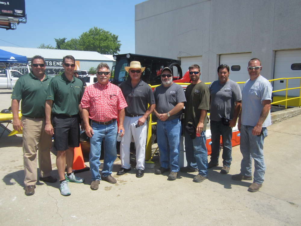 (L-R) are Mike Ruddy, McCann Industries; Jim McCann, president McCann Industries; Scott Sinnett, president Sinnett Excavating Inc.; Dennis Tovar, McCann Industries; Tom Thurman, highway commissioner, Dorr township; and Don Limbaugh, Jeremy Brokaw and Nick Lechner, all of Dorr Township highway department.