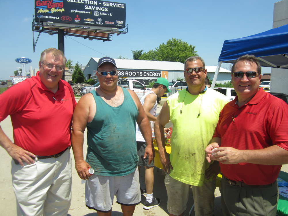 (L-R): Tim Murphy, Paladin Attachments; Chris Savino and Brent Thelen, both of Arnie's Excavating; and Jeff Vodnik, Takeuchi regional product manager, share a laugh during the event.