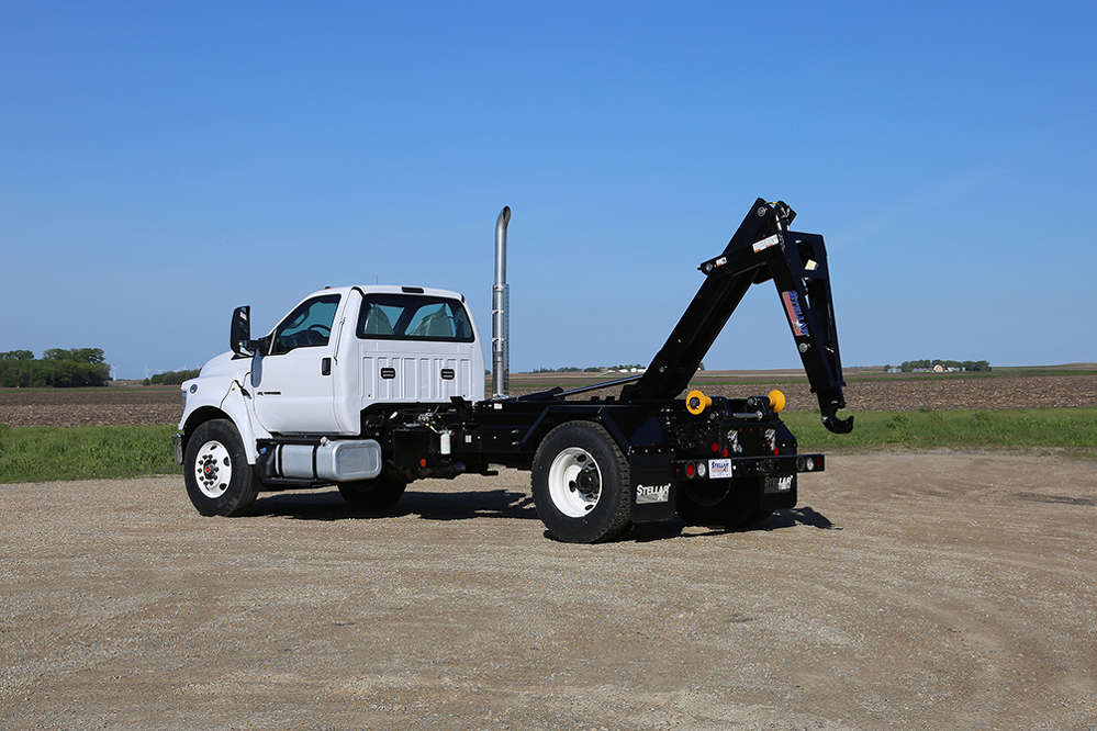 The Stellar 20,000-lb. (9,072 kg) capacity Hooklift is a truck-mounted hydraulic system that is capable of interchanging various bodies.