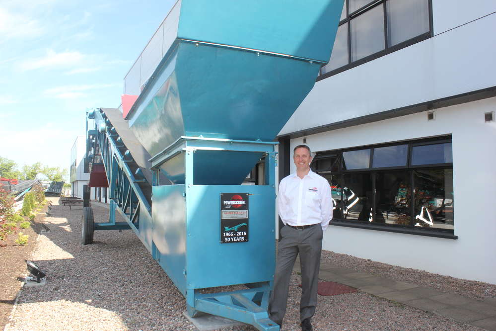 Colin Clements, Global Product Line Director beside a 1966 MK1 screening machine.   This was the sixth machine built and remains a permanent feature at the front of our Dungannon Plant.