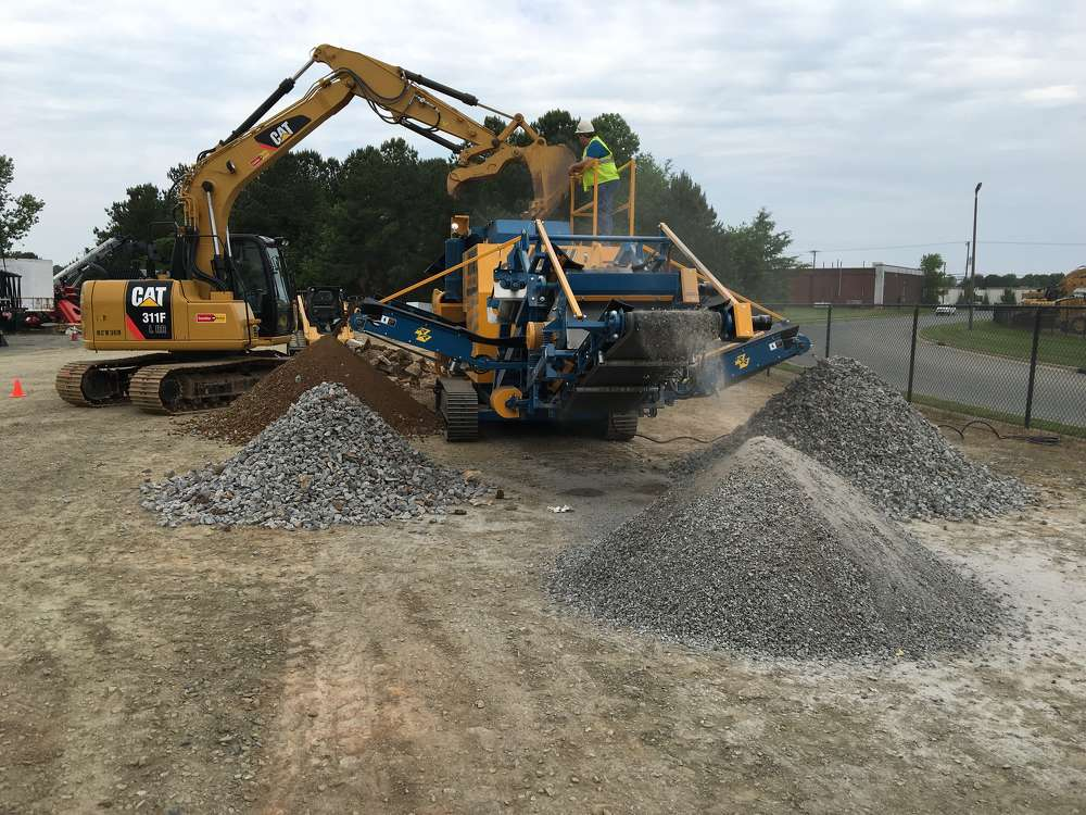 The Rebel Crusher crushes and separates the material into four separate stockpiles.