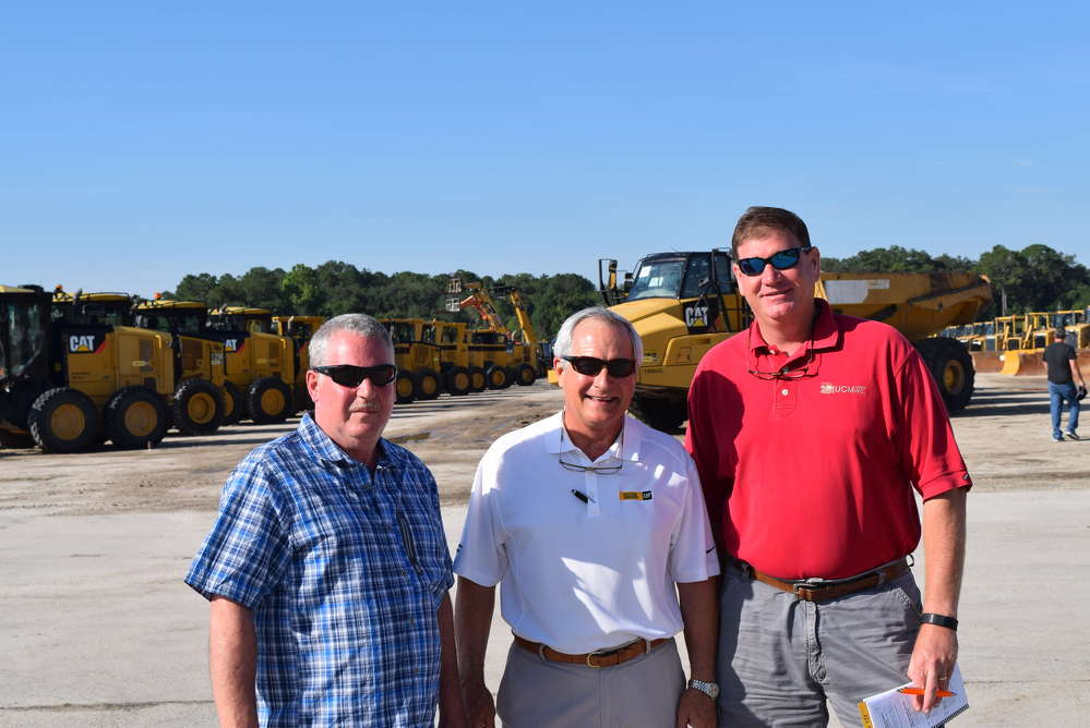 (L-R): Tom Couser, Equipment Corp.; Scott Linder, IronPlanet; and Jamie Wurthmann of UCM take a break from the auction.