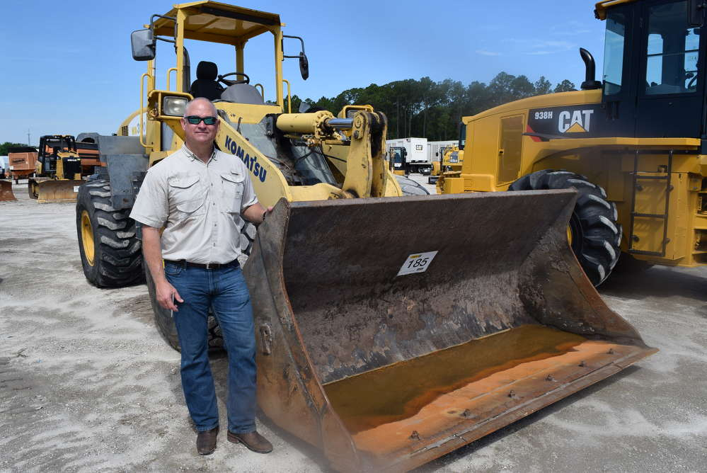 Bo Ross of Linder Industrial Machinery looks over this Komatsu dozer.