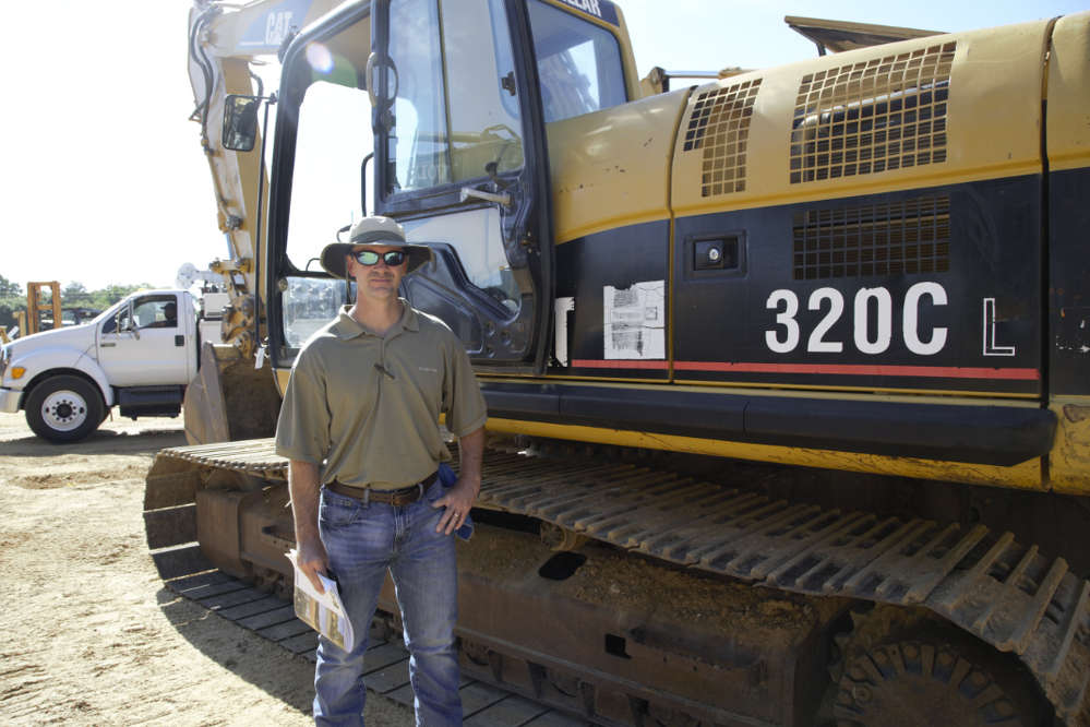 Mark Yarbrough of Interac Corporation inspects this Cat 320C L.