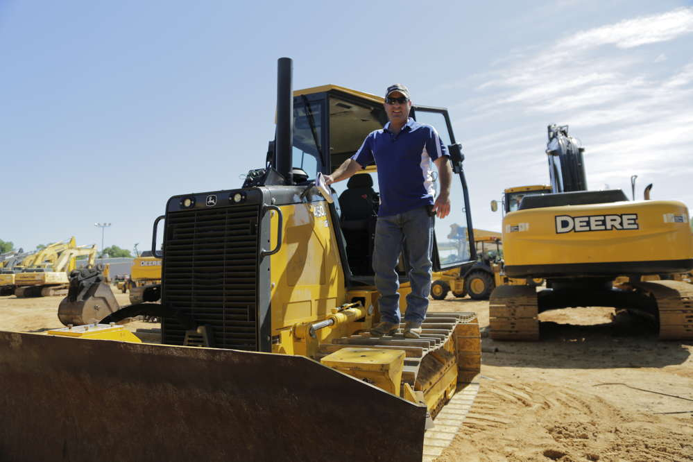 Trevor Cline of Cline Excavators gets a better view of the sale.