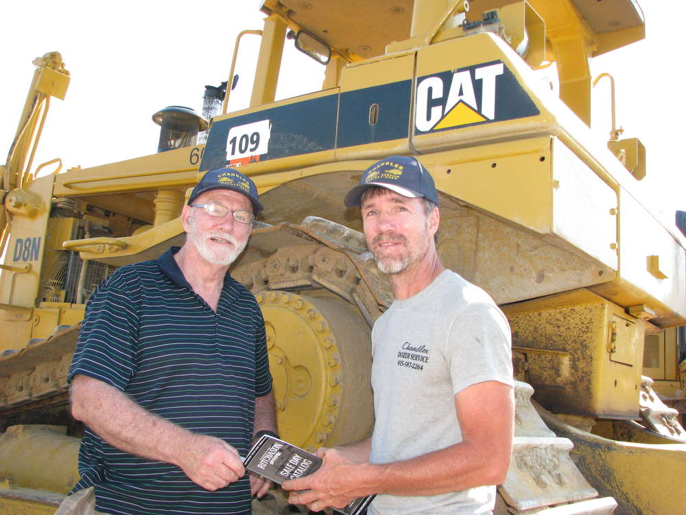 Charles (L) and  Matt Chandler, Chandler Dozer Service, Ashland City, Tenn., look over the equipment.