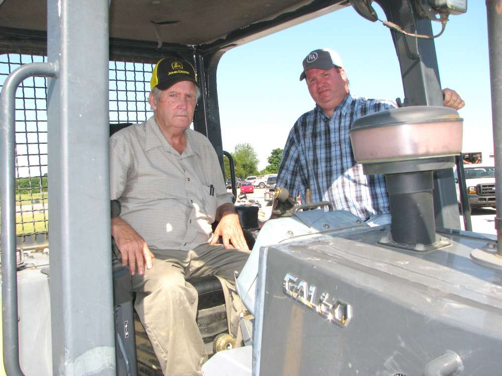 Charles (L) and William Goolsby, WCG Equipment, Bloomington Springs, Tenn., test dozers at the sale.