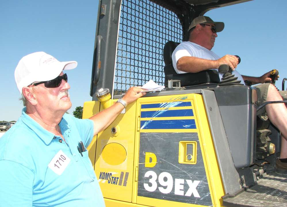 B.Y. Peery (L) and Kenny Bishop, both of Peery Enterprises, Dickson, Tenn., inspect this Komatsu D39EX dozer.