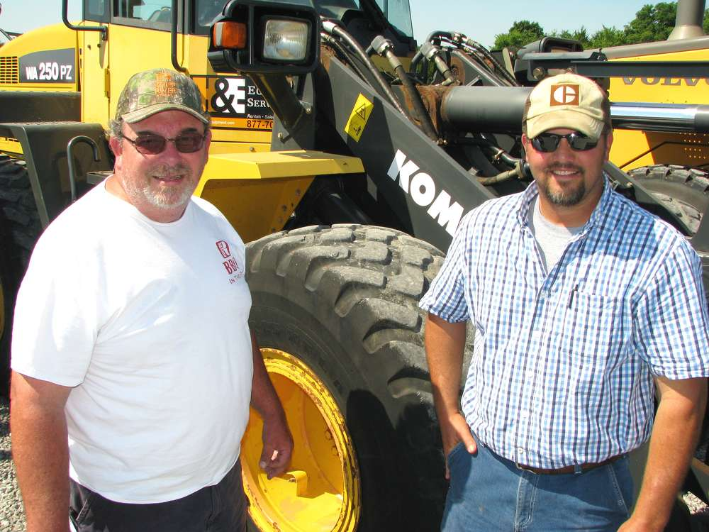 Bud Fultz (L), Old South Excavating, Murfreesboro, Tenn., and Jake Jacobs, Jacobs Construction, also based in Murfreesboro, shop for wheel loaders.