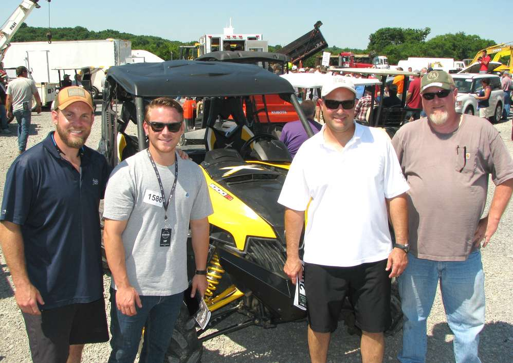 Several auction regulars look for bargains, including (L-R) Doug Campbell, Knock-On-Wood Tree Services & Landscapes, Franklin, Tenn.; Chad Ray, Leasing Systems Inc., Nashville, Tenn.; Wayne, Wantz, Modern Construction, Nashville, Tenn.; and Jeff Gamble, Jeff Gamble Trucking, Hopkinsville, Ky.