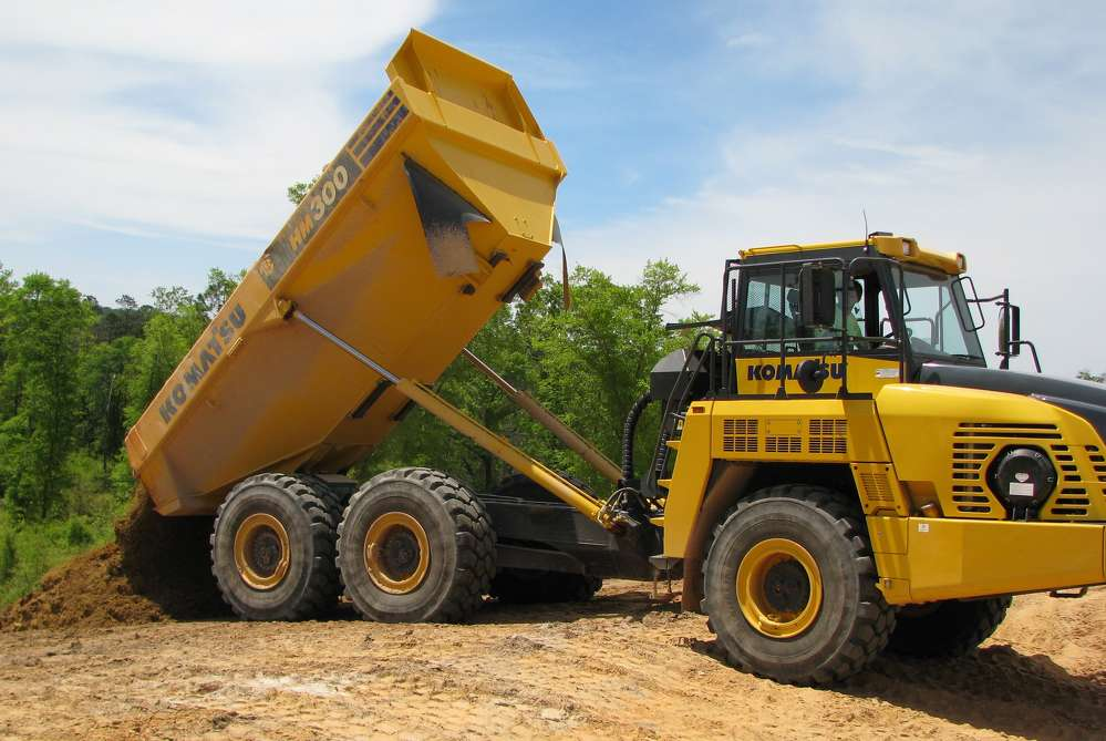 Gulf Hauling & Construction operates machines purchased from Tractor & Equipment Company on the company's job sites, including Komatsu earthmoving equipment and Hamm compactors.