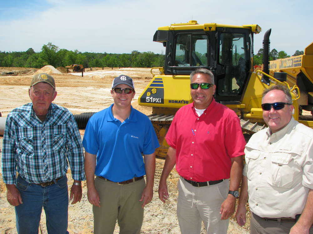 (L-R): Mike Jones and Michael Eubanks of Gulf Hauling & Construction; Chris Howard of TEC; and Mike Eubanks of Gulf Hauling & Construction meet at a job site in Saraland, Ala.