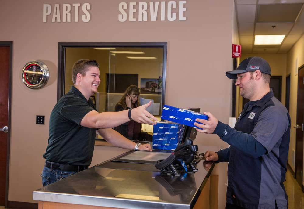 Papé Kenworth's Jerrid Langdon (L), provides Central Oregon Truck Company maintenance shop foreman Travis Seeger his expertise in keeping high-demand parts in stock for the company maintenance shop, which handles routine preventive maintenance on a fleet of 250 Kenworth trucks.