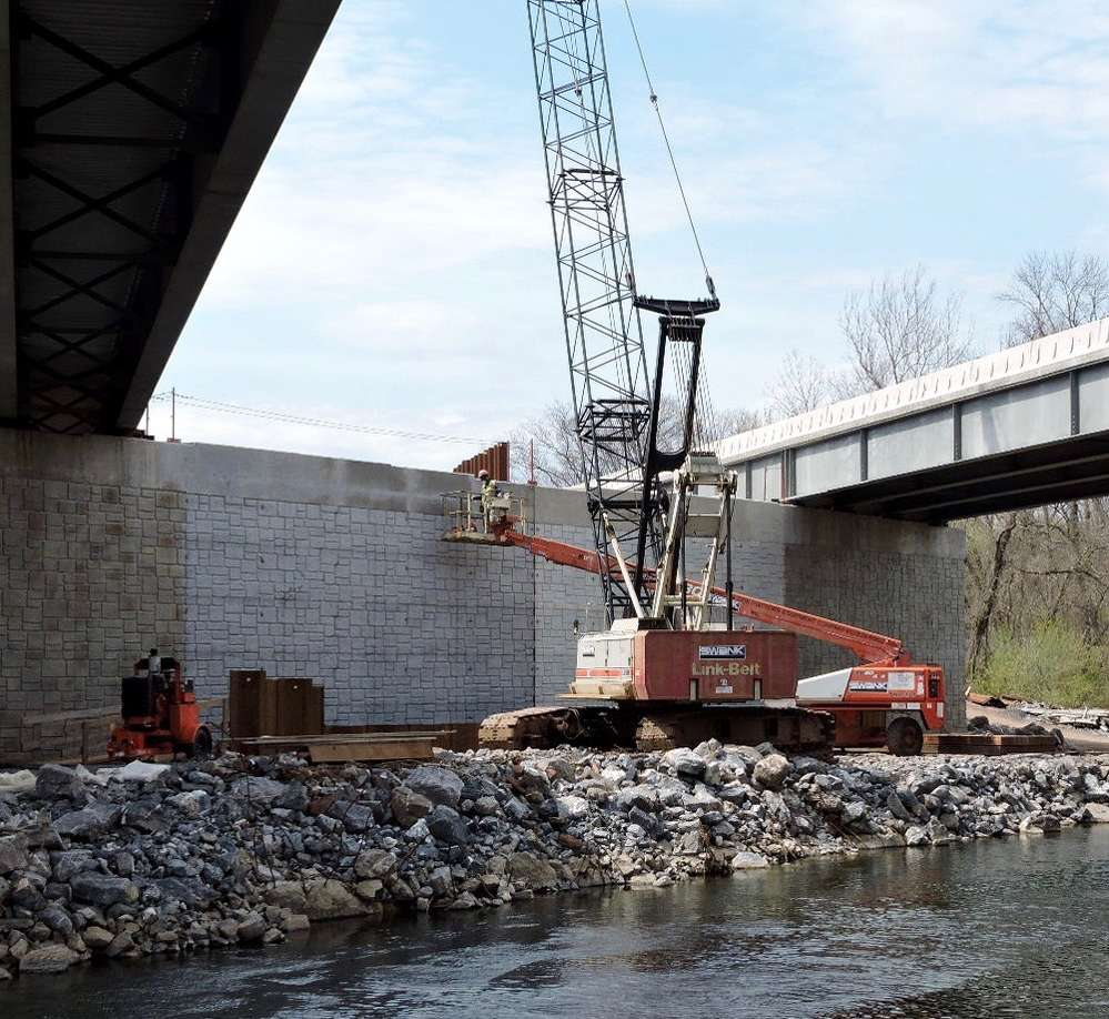 The new bridges over the rail line and Vine Street in Middletown will each be single-span, pre-stressed concrete box beam structures, set atop new abutments, with reinforced concrete decks.