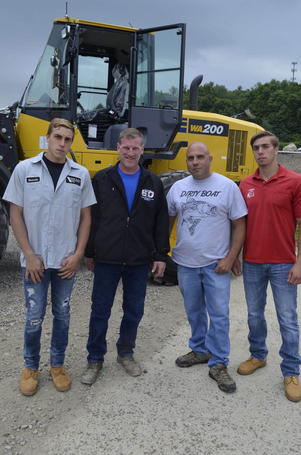 Mark Hufcut (second from L), manager of Pine Bush Equipment's Holmes, N.Y., store, checks out the Komatsu WA200 loader with Nunzio Cassese (third from L) and his sons from Cassese & Sons Construction in Shrub Oak, N.Y.