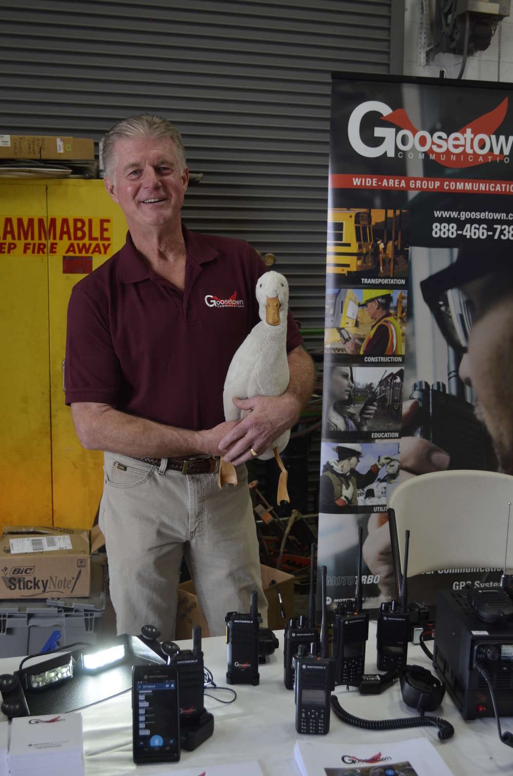 Dave DeJong of Goosetown Communications, along with his pet duck mascot, explained to attendees the wide variety of Motorola Communications solutions his company has available.