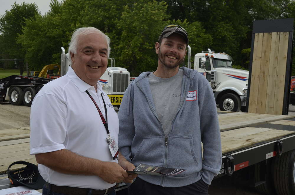 Mike Flynn (L), factory representative of Felling Trailers, discusses the lowboy needs of Martin Grabowski, president of Grabowski Masonry in Middletown, N.Y.