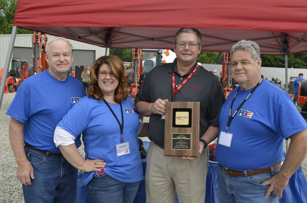 ESCO presents Pine Bush Equipment an award recognizing its outstanding contribution for more than 30 years as an ESCO dealer.  (L-R) are Tom Boniface, Pine Bush Equipment past president; Holly Bodnar, Pine Bush Equipment president; Dave Nightlinger, ESCO; and Steve Boniface, Pine Bush Equipment CEO.