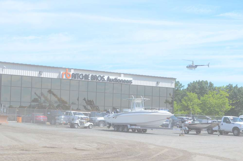 The June 14 Ritchie Bros. auction in North East, Md., was the auctioneer's largest sale there since 2008 — and it brought in bidders from all over the world, some even by helicopter.