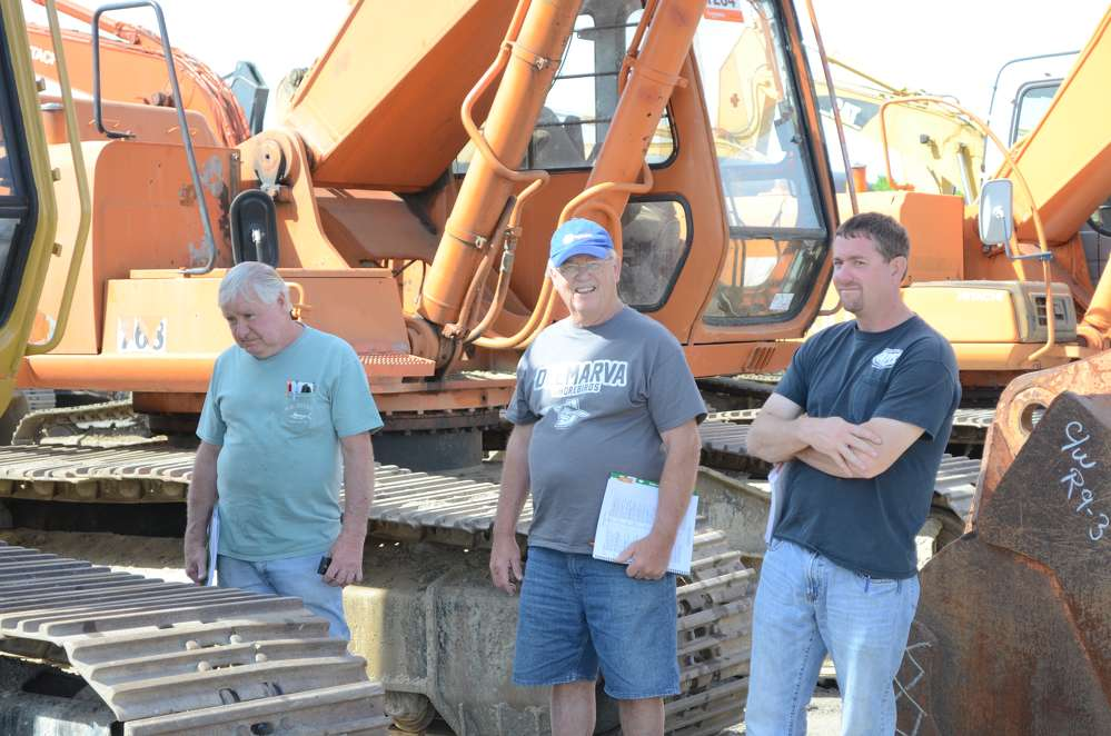 (L-R): John Yates, Kenny Short and Charles Short are enjoying the great weather and the Ritchie Bros. auction in North East, Md.