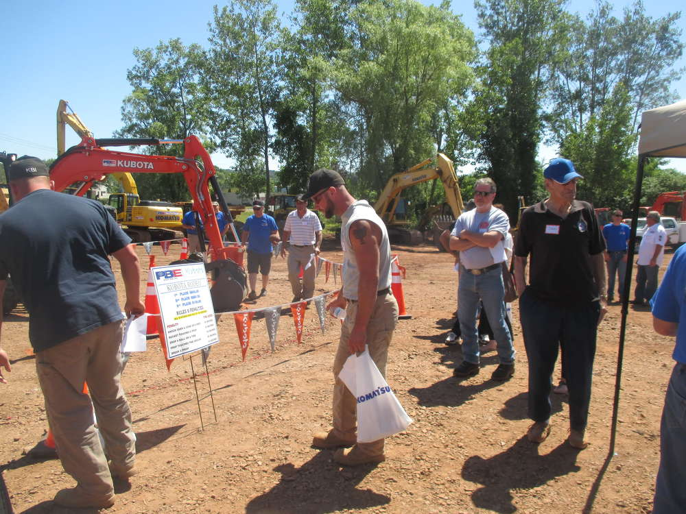 Guests wait their turn to take on the excavation rodeo for a top skills prize of $500. Door prizes and great raffle prizes were given out all day long.