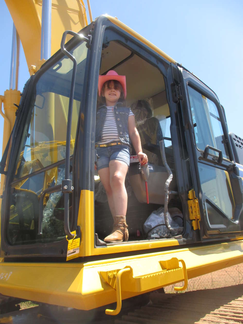 Cecilia Ruiz, wearing an impressive pink cowboy hat, enjoyed the machinery. Cecilia was visiting with her grandparents, owners of Orlando Excavation Inc., of Chaplin, Conn.