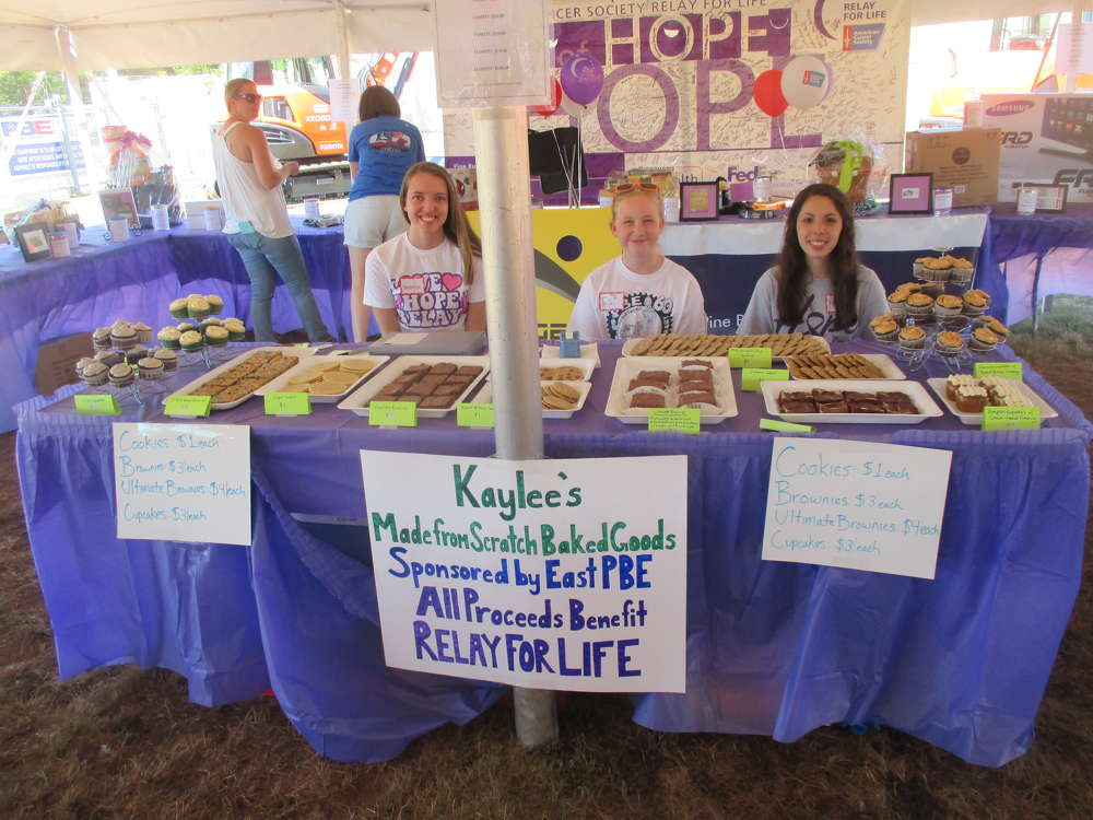 (L-R): Natalia Rozio, Faith Light and Kaylee Simonds man the bake sale to raise money for Relay for Life, benefitting cancer research.