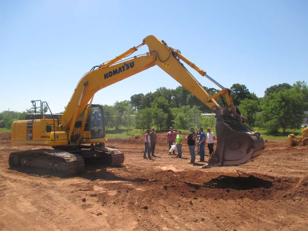 Guests gather for a demonstration of Komatsu's PC210LCi excavator with Intelligent Machine Control (IMC).