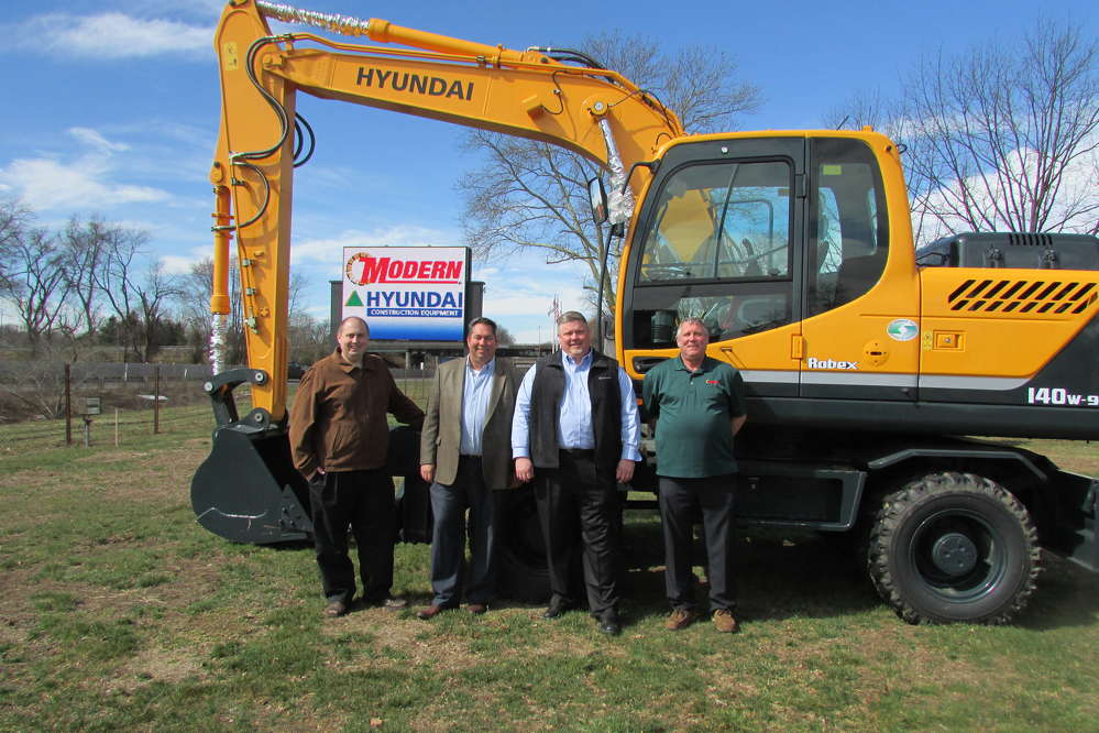 Proud to be representing the full Hyundai line (L-R) are Greg Plefka, marketing director; Sam Maury, general manager of the heavy construction equipment; Rick Nelson, vice president and general manager; and Mark Dombrowski, sales manager.