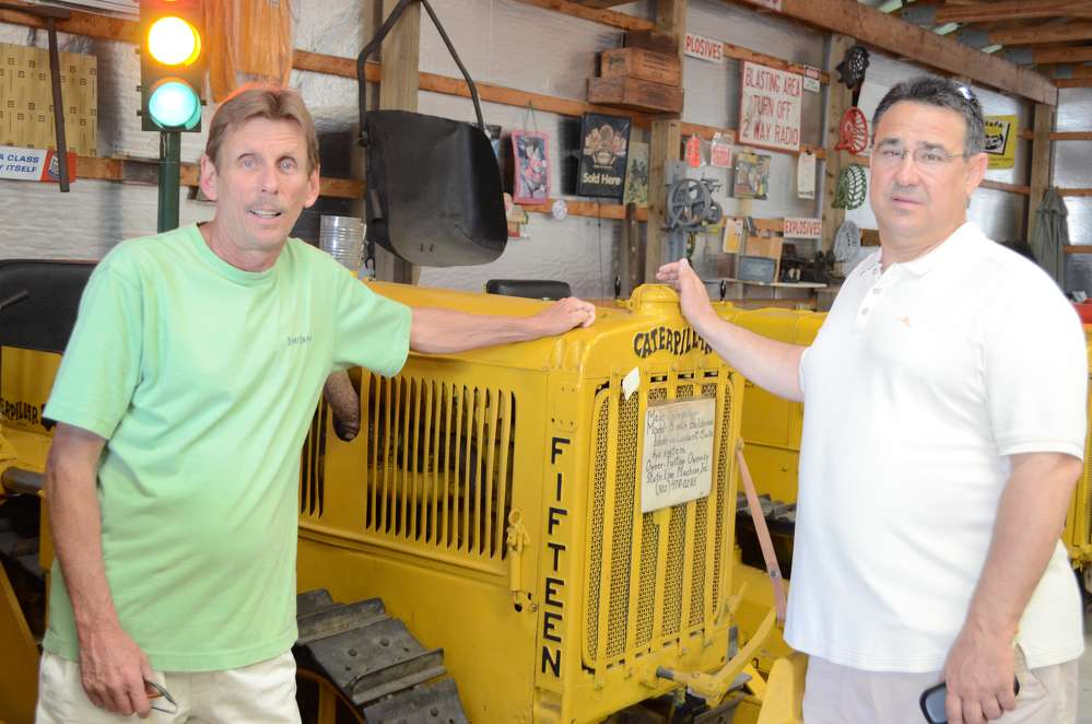 Jeff Thomas (L) and Mark Grubb, both of the State of Delaware's Department of Communication, check out an old Caterpillar Model 15.