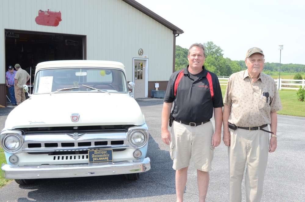 Fulton Owensby Jr. (L) and Fulton Owensby Sr. stand in front of the award-winning 1957 Ford F1 pickup.