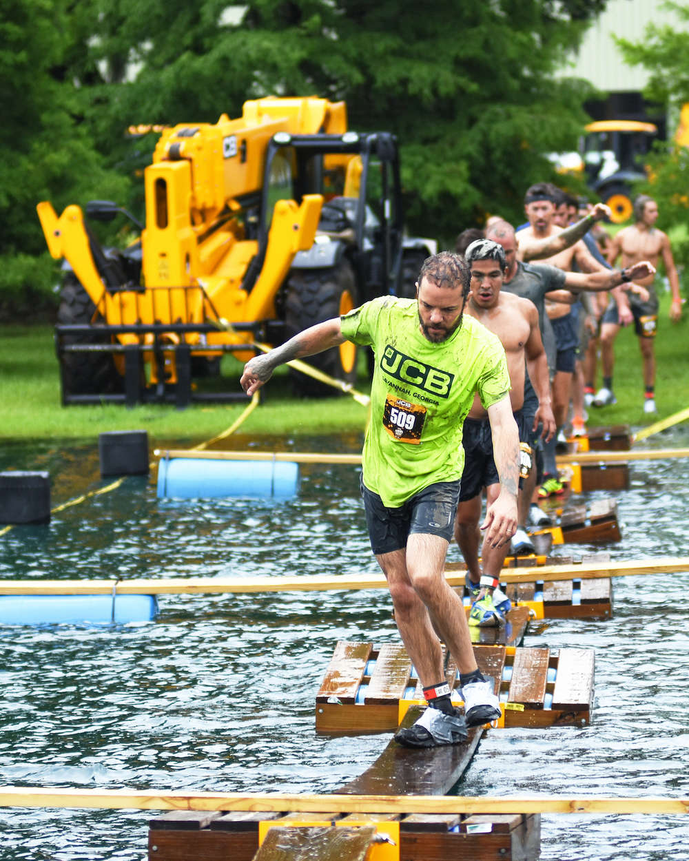 Runners completed 43 obstacles, including a splash through the JCB lake.