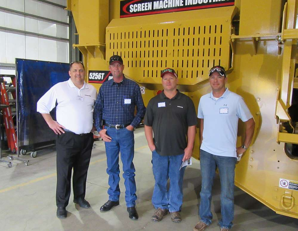 (L-R): Mike Thurman of Screen Machine Industries discusses the 5256T portable Impact Crusher with Paul Ford, Keith Hensel and Zane Luttrell of Power Equipment Company.