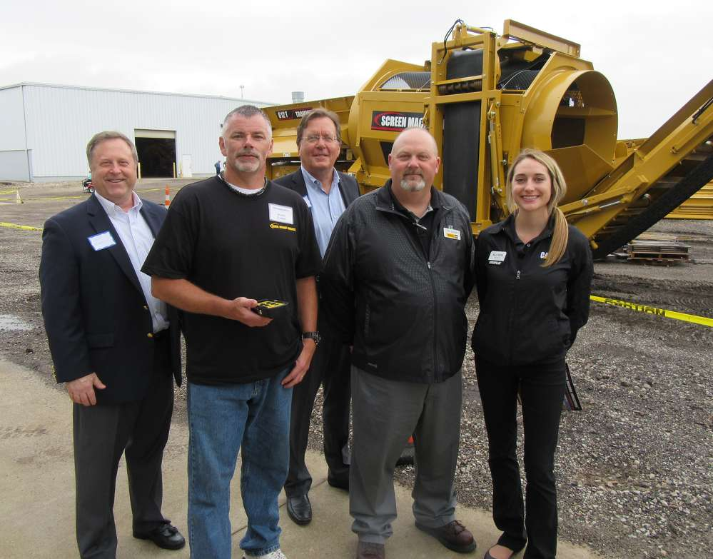 Screen Machine's Wayne Ellison (2nd from L) demonstrates the remote control capabilities of this 612T portable trommel screen for (L-R) Ohio Manufacturers' Association's Daniel Noreen and Eric Burkland; Ohio CAT's Tony Skaggs; and Caterpillar's Allison Pepper.