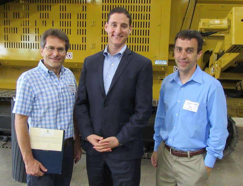 Screen Machine Industries President Steve Cohen (L) and Vice President of Operations Doug Cohen (R) are congratulated by Treasurer of Ohio Josh Mandel.