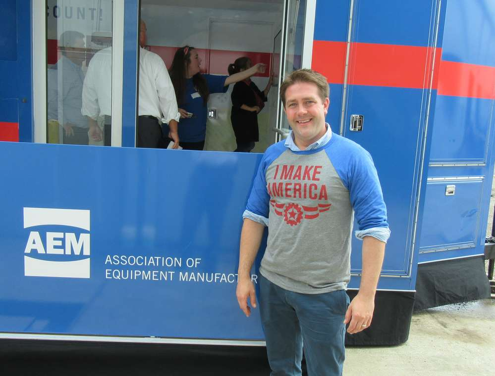 "The Association of Equipment Manufacturer's Kip Eideberg was on hand with the assocation's traveling interactive educational game trailer to promote the ""I Make America"" campaign."