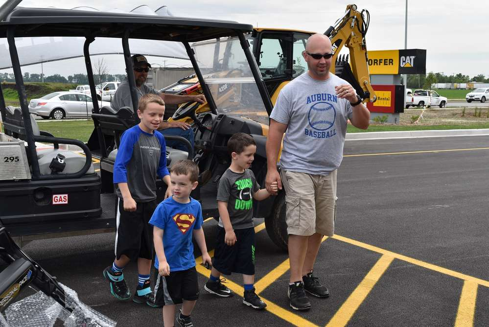 (L) Doug Edwards, Altorfer painter, drops off Altorfer customer Butch Flowers (R) and his children (L-R) Zach, Brody and Ty Flowers.