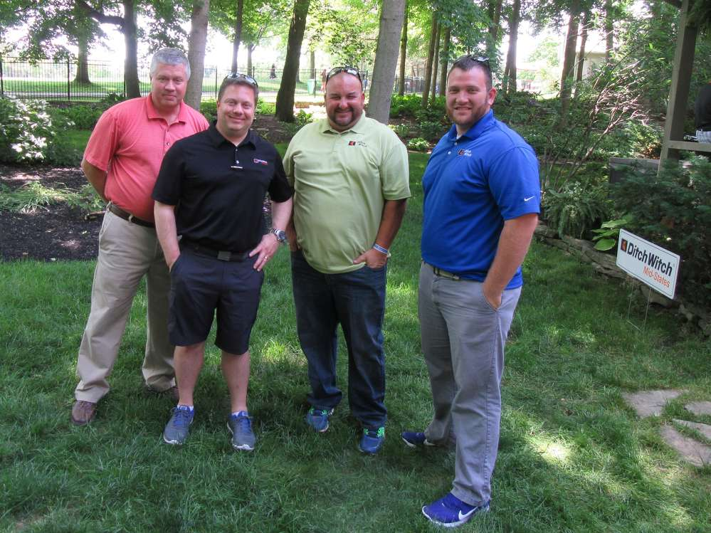 (L-R): Billy Lenberger, Andrew Lazzaro, Brian Wills and Elliott Carter, all of Ditch Witch Mid-States, work to ensure their guests are enjoying their time.